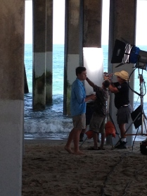 "Scotty McCreery and video crew prepare to shoot another take of him lip-syncing to ""I'm Feelin' It."""