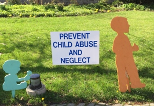 One of many signs posted around my city during Child Abuse Prevention Month.