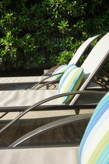 Lounge in the sun with fun striped lumbar pillows.